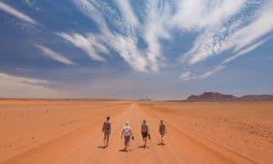 people walking in the desert