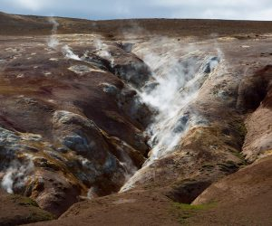 Geothermal steam rising from ground in the M˝vatn area of Iceland