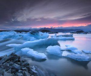 Icebergs floating in Jokulsarlon glacier lake at sunset.South Iceland.