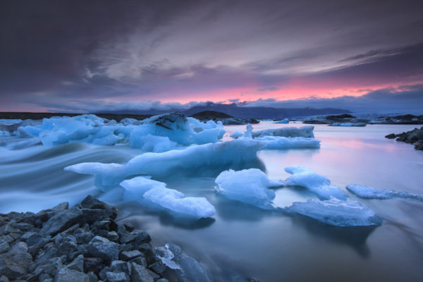 Icebergs floating in Jokulsarlon glacier lake at sunset.South Iceland.