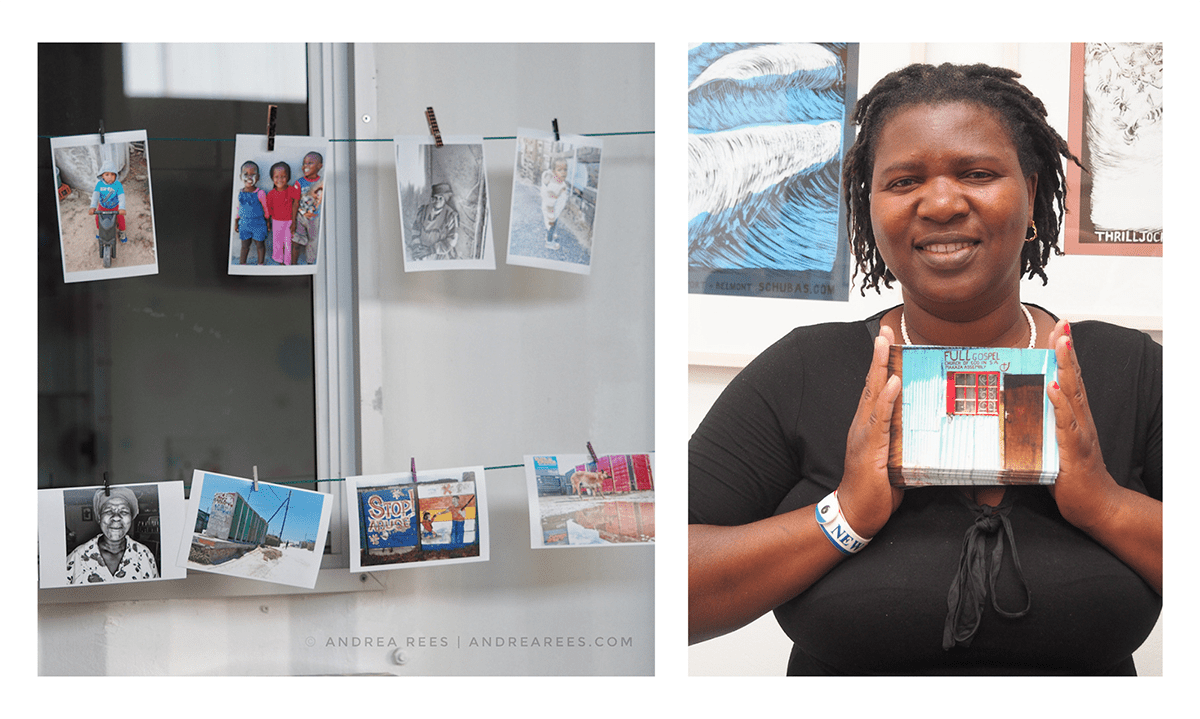 Photograph of photographs hanging from a line next to a photograph of a woman holding a postcard