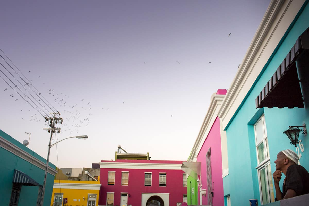 A view of the sky, framed by the colourful houses of Bo-Kaap by Sarah Isaacs