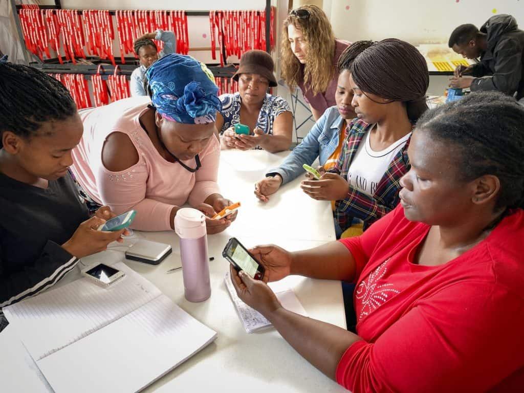 Volunteers using provided phones